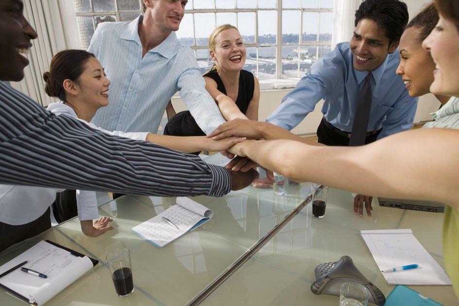Business people showing team spirit